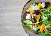 bowl of vegetable salad with walnuts